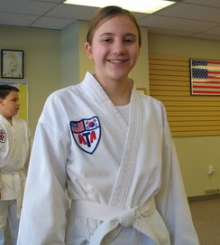 Miss Elizabeth Nash, currently a 3rd Degree Black Belt, as a white belt in 2004.